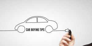 Man drawing a car with car buying tips written