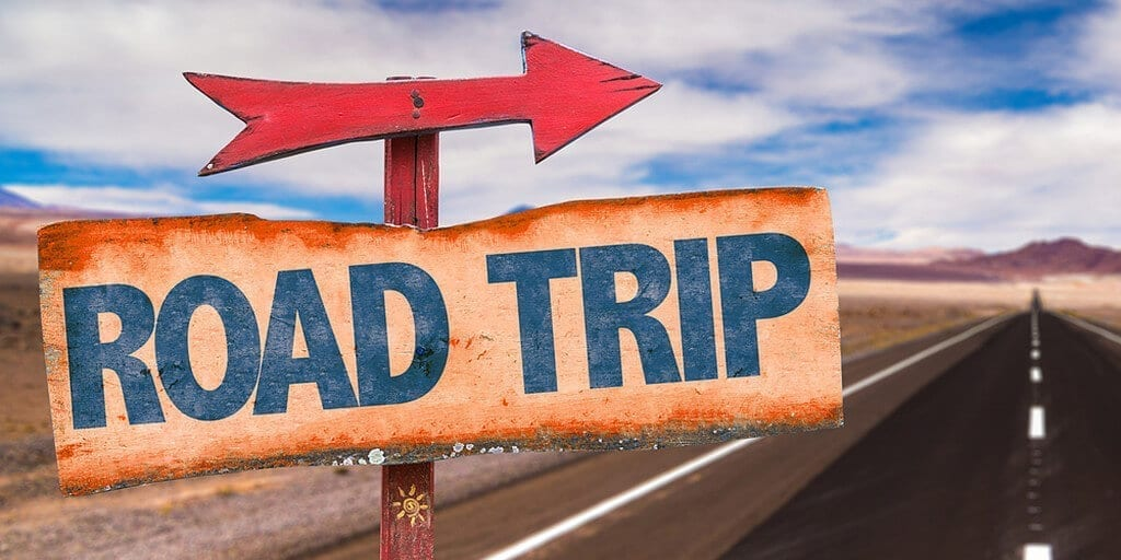 Arrow On Sign That Says Road Trip