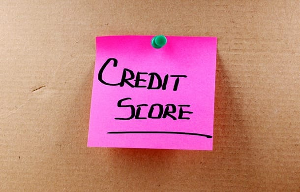 Postit note with Credit Score written on it