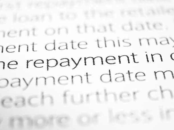 Paper with car loan repayments